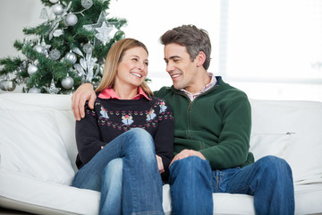 Couple Relaxing On Sofa During Christmas