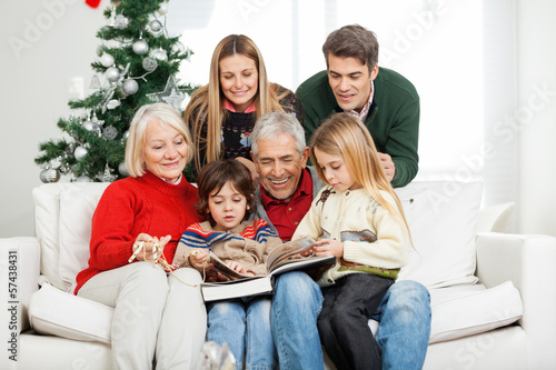 Family Reading Book Together In House