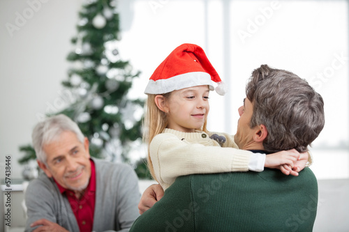 Girl Embracing Father During Christmas