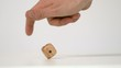 Hand letting twist a wooden dice