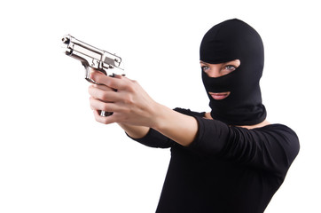 Burglar with handgun isolated on white