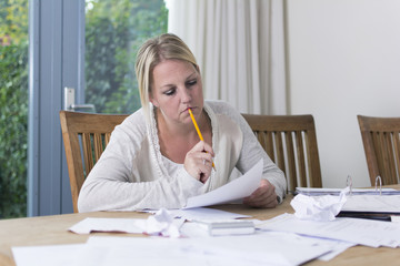 Woman with debts worrying. Financial problems.