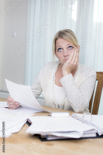 Woman with debts worrying