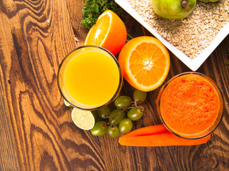 Fresh vegetable and fruits juices on wood