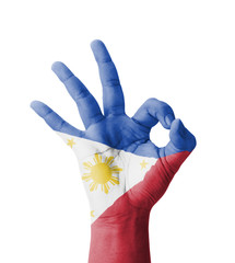 Hand making Ok sign, Philippines flag painted