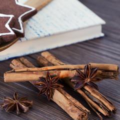 Cookies, star anise, cinnamon and cookbook
