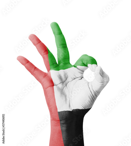 Hand making Ok sign, UAE (United Arab Emirates) flag painted
