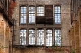 Old windows i a abandoned hall