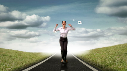 Happy businesswoman jumping in front of flying sheets