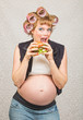 Pregnant Woman Eating a Sandwich