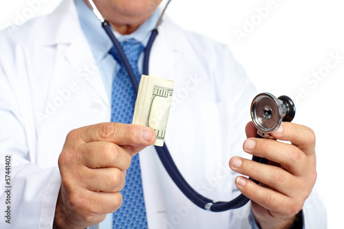 Hands of medical doctor with money.