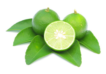 Green lemon with leaves isolated on white