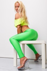 Sexy blond sporty woman in green leggings