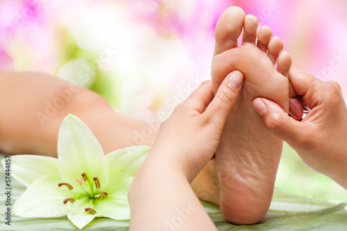 canvas print picture Therapist hands massaging foot.