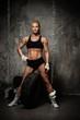 Beautiful muscular bodybuilder woman