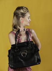 Portrait of retro looking woman with handbag