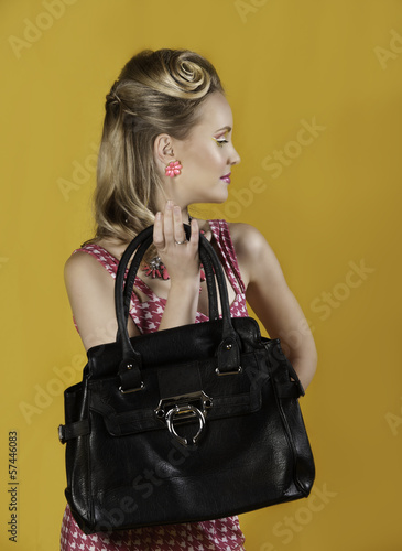 Portrait of retro looking woman with handbag