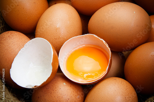 broken chicken eggs and egg yolk