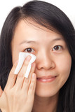 Woman cleansing face poster