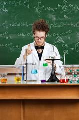 Crazy professor works in his laboratory