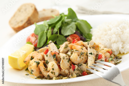 healthy dish of fried chicken and shrimps with watercress and wh