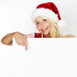 Women with santa hat pointing at a message board