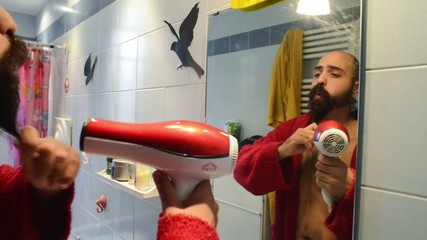 long bearded man in bathroom  drying with bathrobe