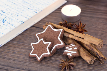 Cookies, star anise, cinnamon and cookbook