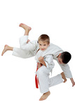 A boy with a red belt doing throw athlete with a white belt