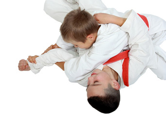 Athlete on a white background with a red belt makes a reception