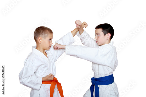 Athletes with orange and blue belt doing reception