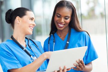 two nurses using laptop computer