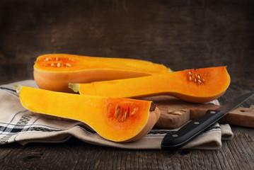 Butternut pumpkin on wooden table