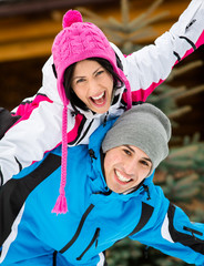 Portrait of couple having fun outdoors during winter vacations