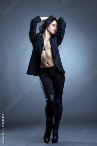 Beddable woman posing topless in stylish clothes