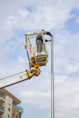 worker on top of a pole fixing the supply 2