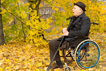 Retired handicapped man in an autumn park