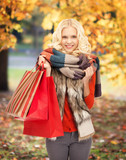 teenage girl in warm clothes with shopping bags