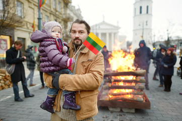 Father and daughter on Lithuanian independence day