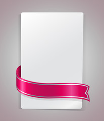 Pink ribbon bending around blank paper card