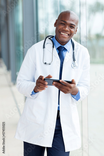 african american medical doctor using tablet pc
