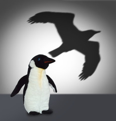 Penguin with eagle shadow. Concept graphic