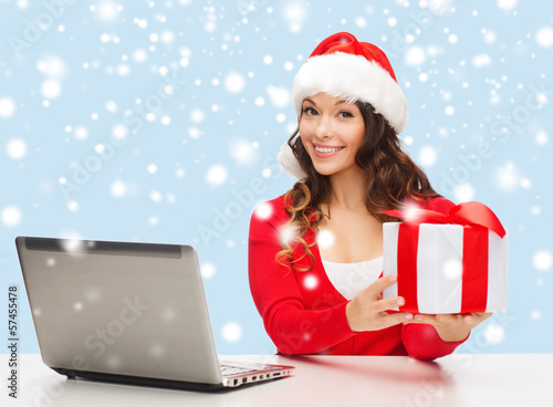 woman with gift box and laptop computer