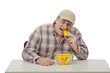 Mature man biting yellow watermelon