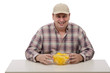 Man in a plaid shirt with juicy yellow watermelon