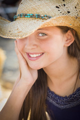 Preteen Girl Portrait Wearing Cowboy Hat