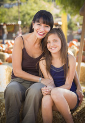 Mixed Race Mother and Daughter Portrait at the Pumpkin Patch.