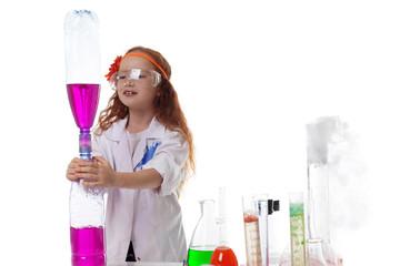 Attentive schoolgirl conducting experiment