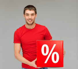 man in shirt with red percent sale sign