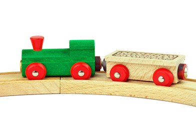 Wooden toy colored train isolated on white background